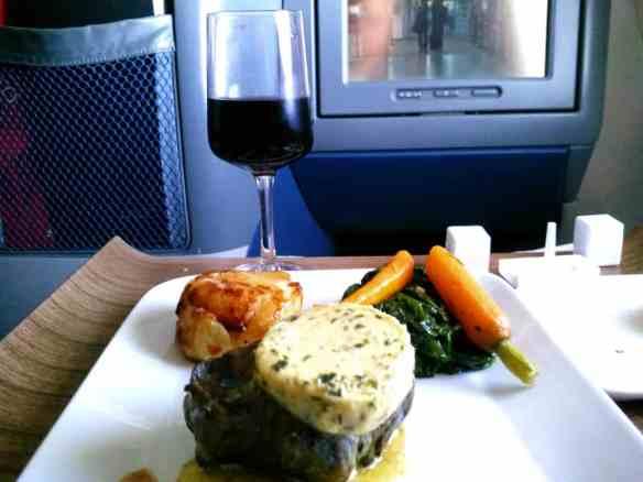Delta elite filet steak potatoes au gratin and spinach meal