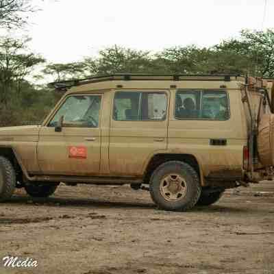 Safari vehicles in the Serengeti National Park