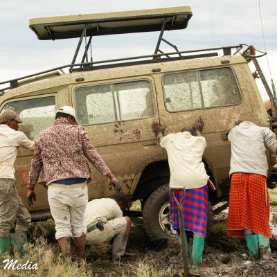 Getting our vehicle out of the mud in the Serengeti National Park