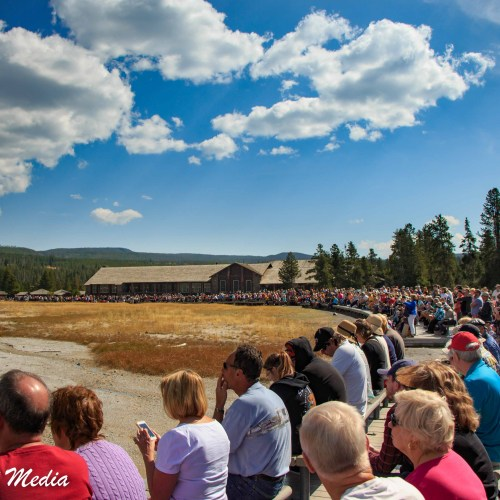 Crowd gathered to watch Old Faithful in Yellowstone National Park