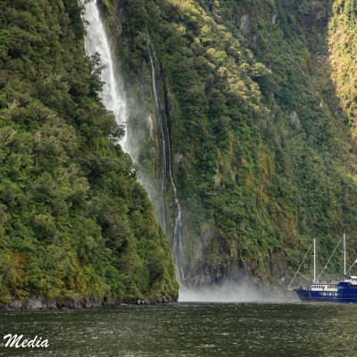 Boat Tour Under a Waterfall in Milford Sound