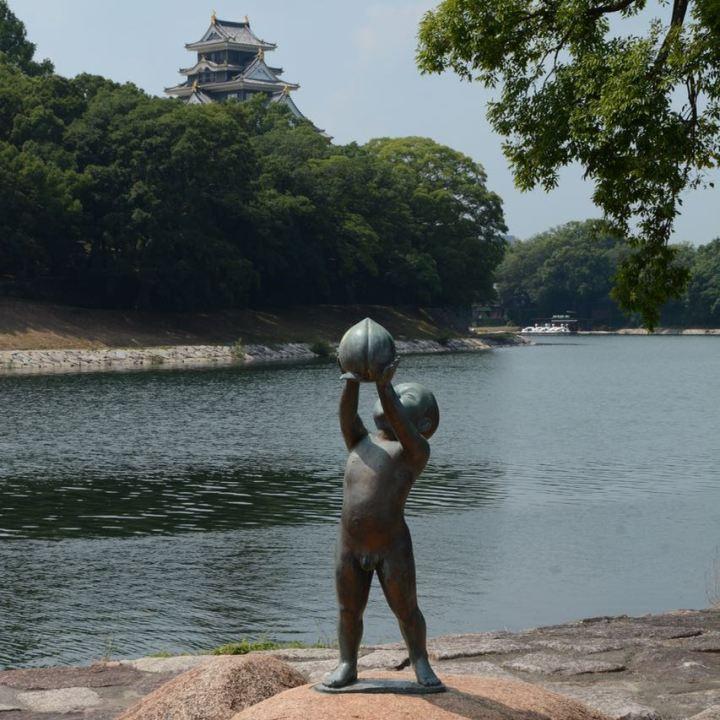 Okayama korakuen garden momotaru statue