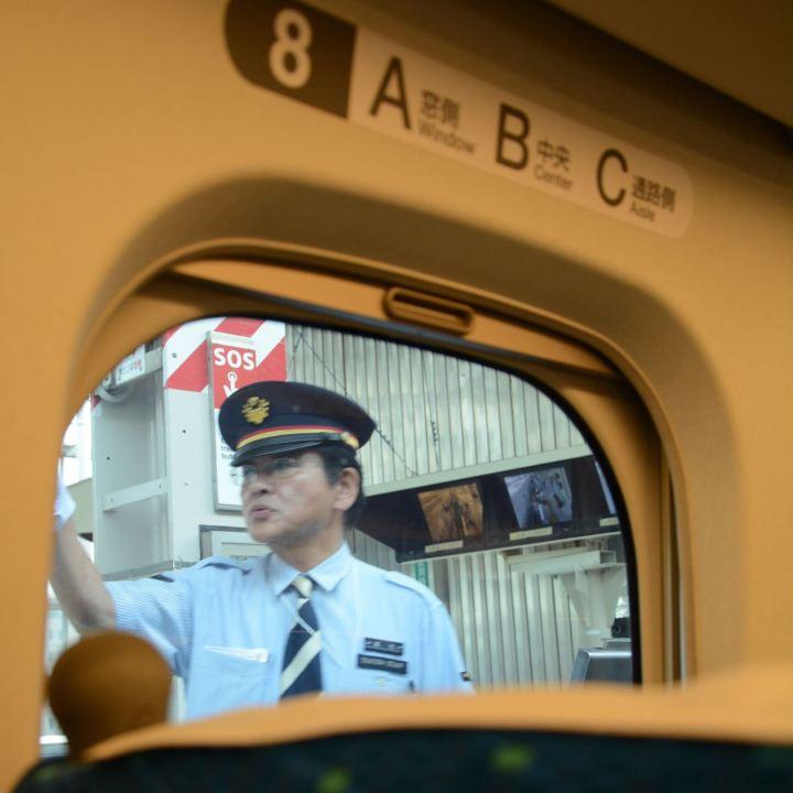 train guard on shinkansen platform osaka
