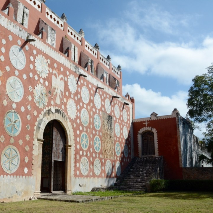 travel with children kids mexico uayma church convent stucco flowers cloister