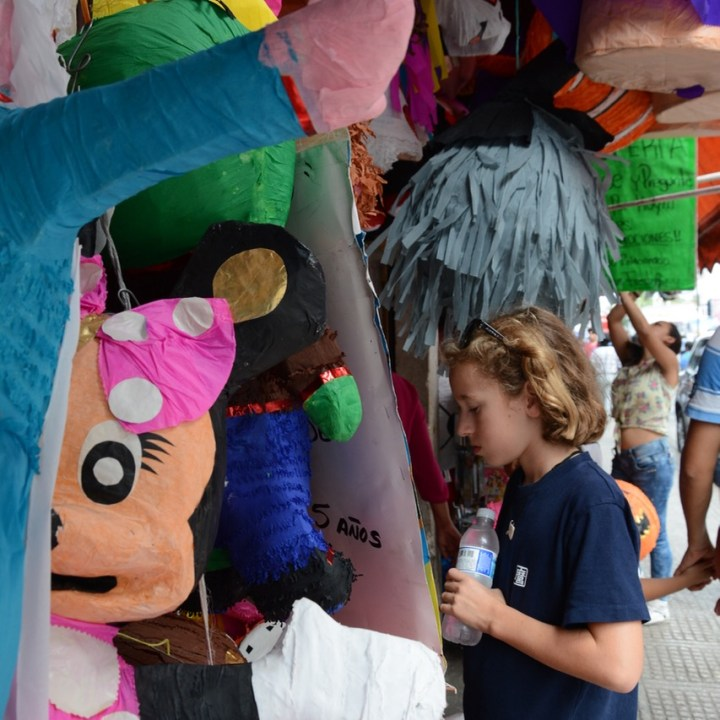 Travel with children kids mexico merida pinata shopping