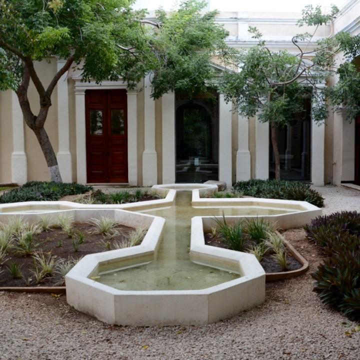 Travel with children kids mexico merida casa de montejo courtyard fountain