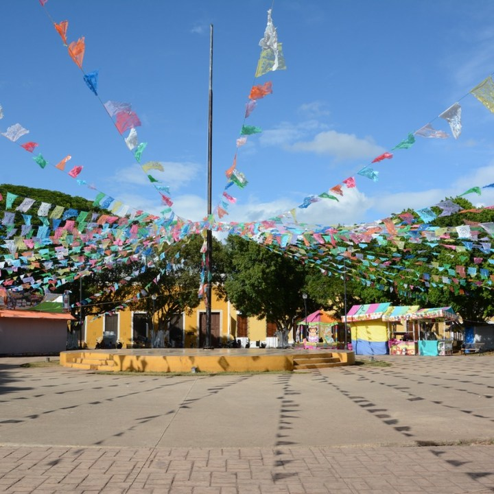 Travel with children kids mexico merida izamal plaza festival decoration