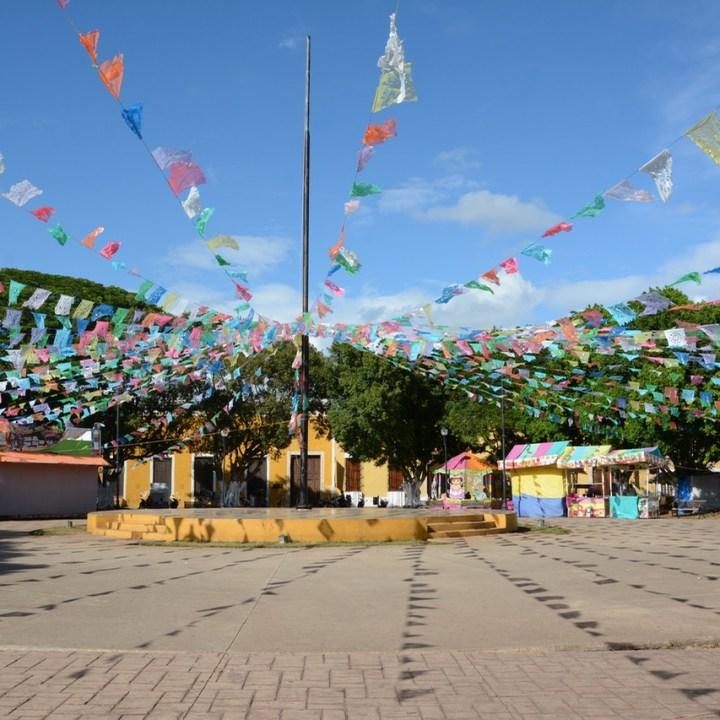 Travel with children kids mexico merida izamal plaza festival decoration