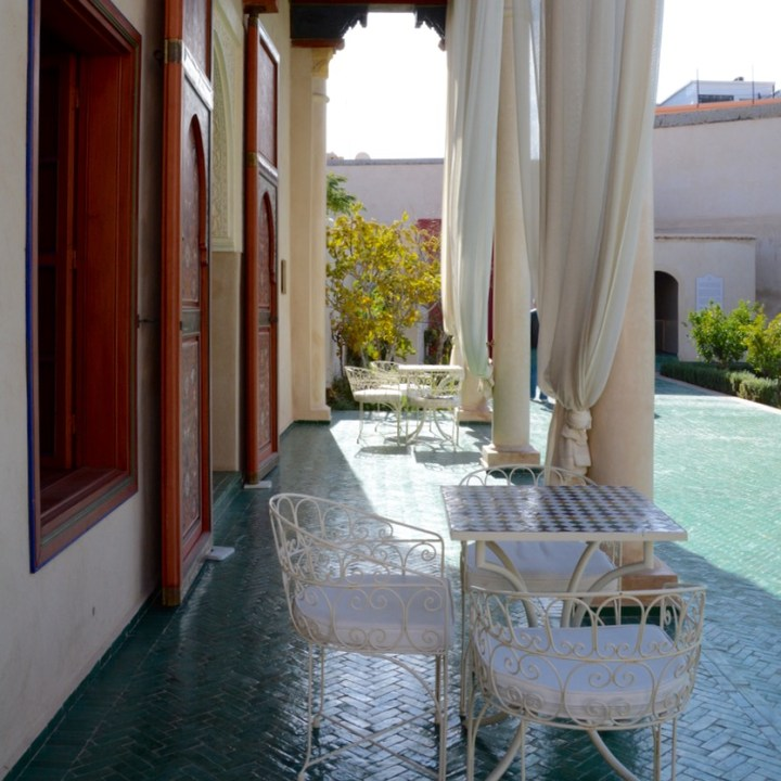 Travel with children kids Marrakesh morocco medina secret garden sitting area