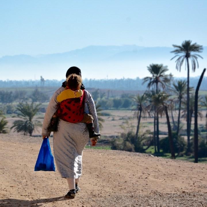 travel with kids children morocco marrakech hotel caravanserai seating mother
