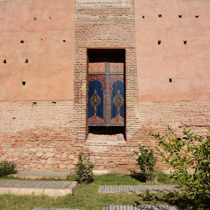 travel with children kids morocco marrakech saadian tombs door