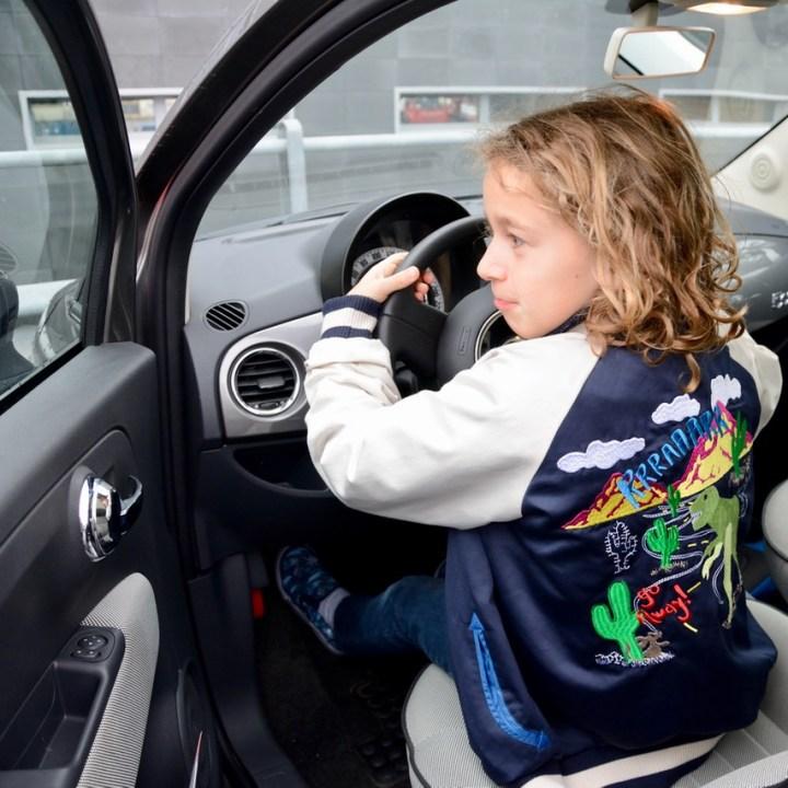 Travel with kids children pisa italy fiat 500