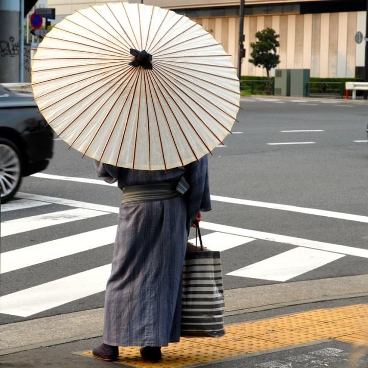 tokyo japan with kids cycling haneda man with parasol