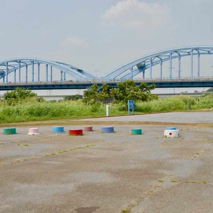 cycling the tama river tokyo japan with kids bridge
