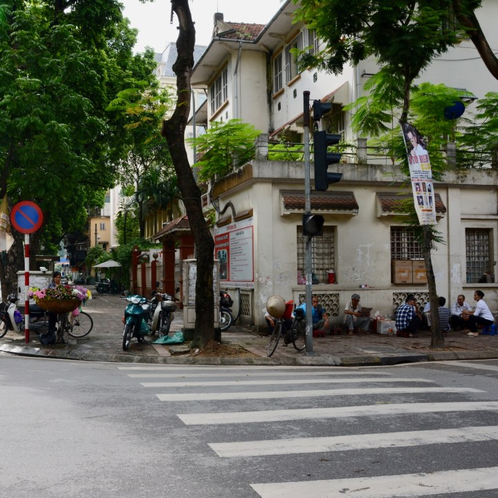 travel with kids vietnam hanoi street cafe