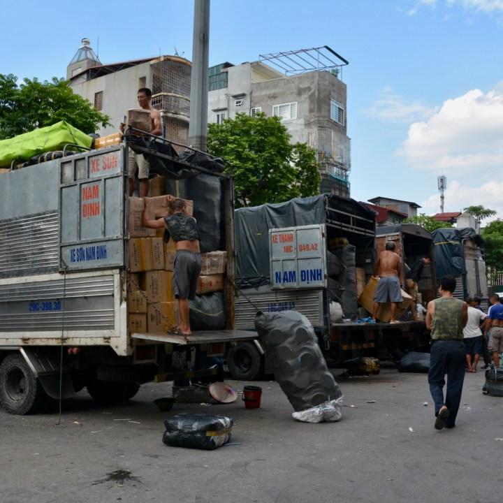 travel with kids vietnam hanoi loading trucks