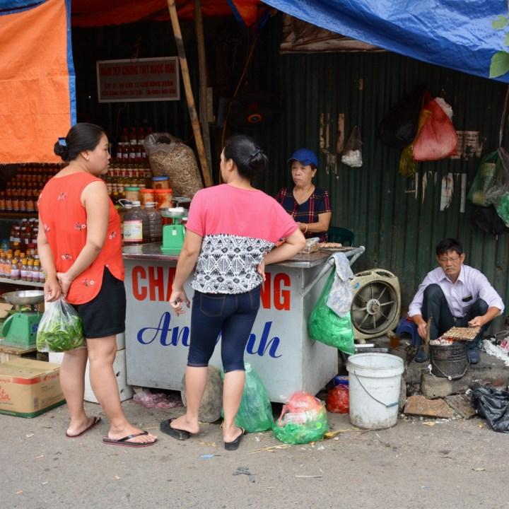 travel with kids vietnam hanoi food stall