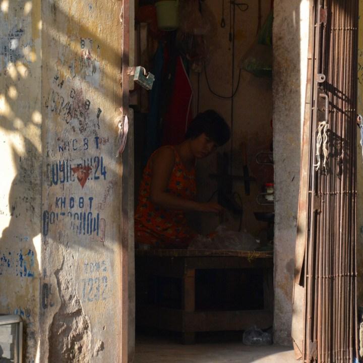 travel with kids vietnam hanoi shop keeper