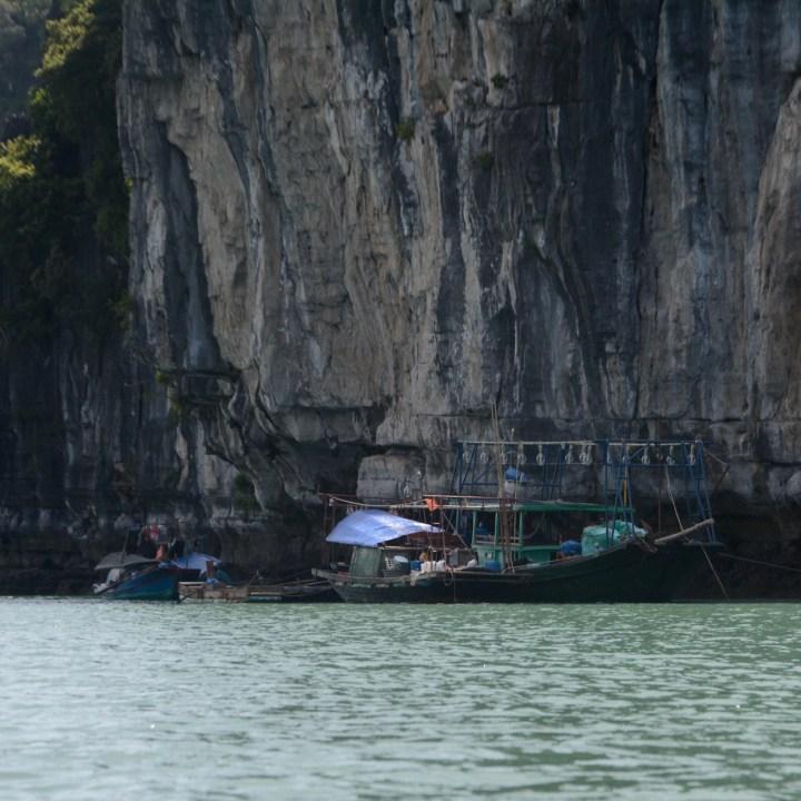 vietnam with kids ha long bay squid fisher