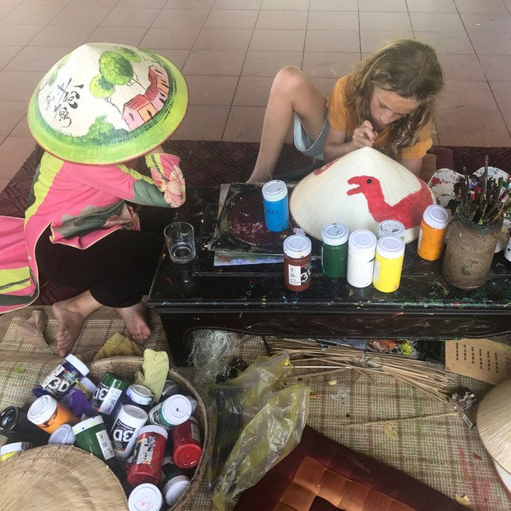 travel with kids vietnam hue hat painting