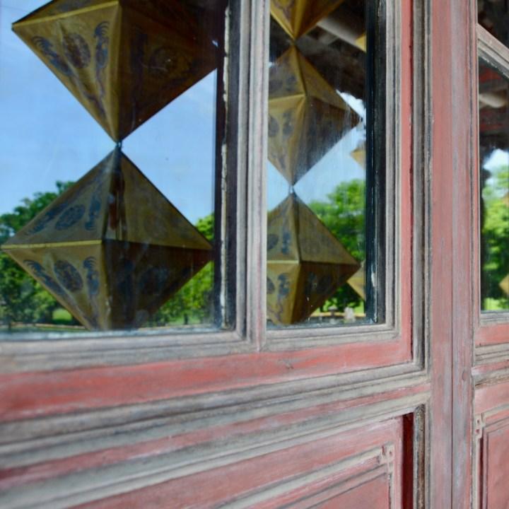 vietnam travel with kids hue citadel lantern reflections