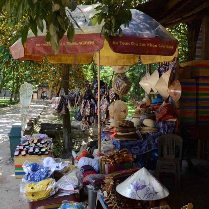 vietnam with kids hue tomb minh mang souvenir stand