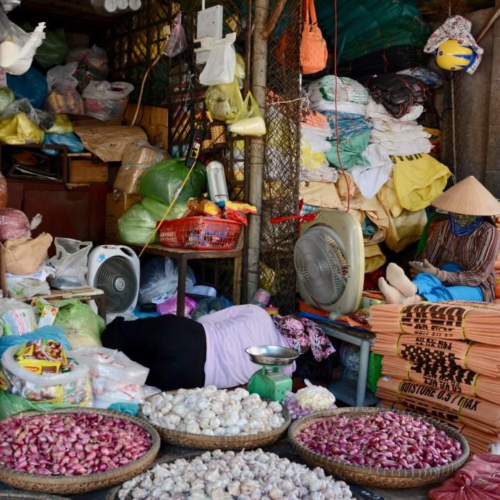 vietnam with kids hue market garlic