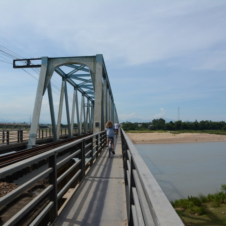 vietnam travel with kids hoi an rural bike ride train bridge