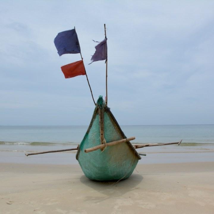 travel with kids vietnam tam than beach boat
