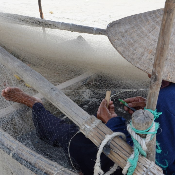 xtravel with kids vietnam tam than beach net repairs