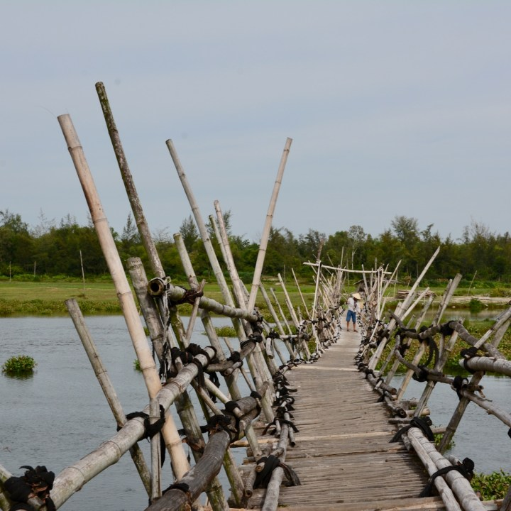 travel with kids vietnam hoi an bamboo bridge fishing