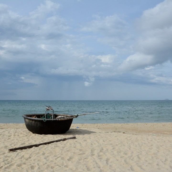 vietnam with kids an bang bike beach traditional boat