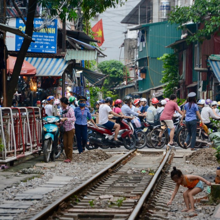 hanoi with kids train crossing motorbike jam