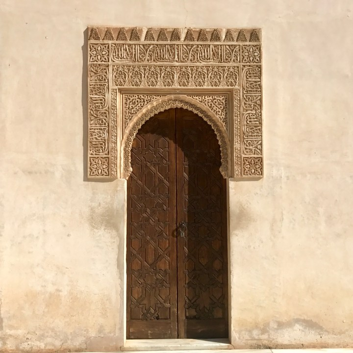 alhambra with kids nasrid palace door