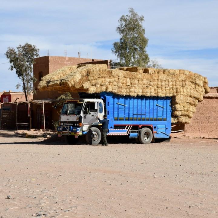 Ait Benhaddou with kids Morocco straw truck