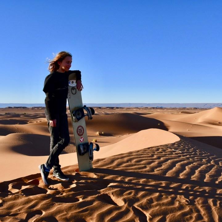 sahara desert erg chigaga with kids sand boarder