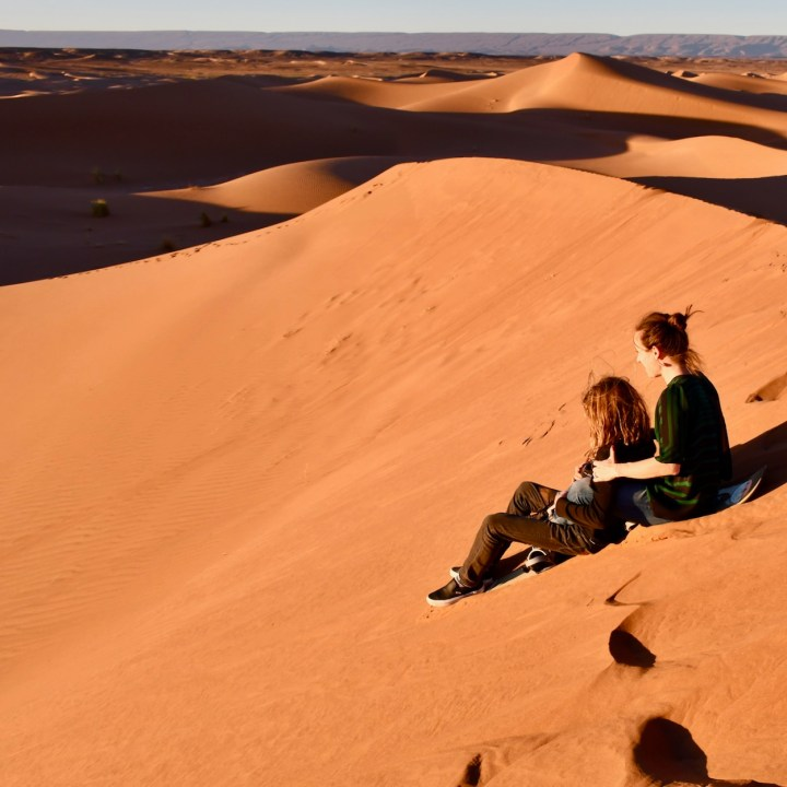 sahara desert erg chigaga with kids sledging