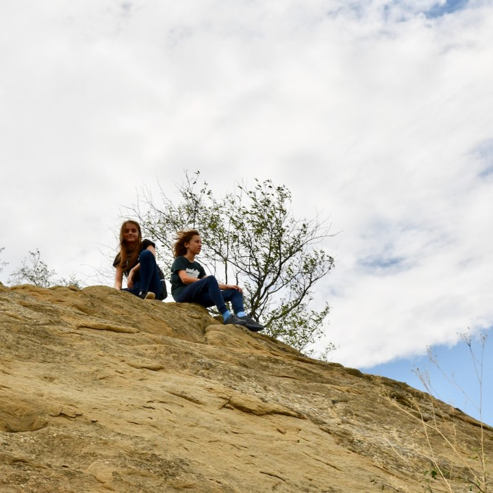 Exploring Georgia with kids climing rocks