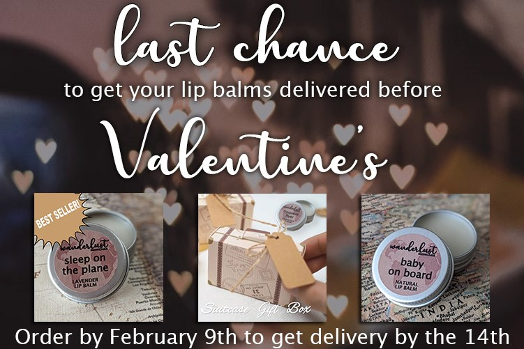 A flyer with photos of two Wanderlust Skincare lip balms and one small gift box that looks like vintage luggage. The lavender lip balm is marked Best Seller. Text says: Last chance to get your lip balms delivered before Valentine's. Order by February 9th to get delivery by the 14th.