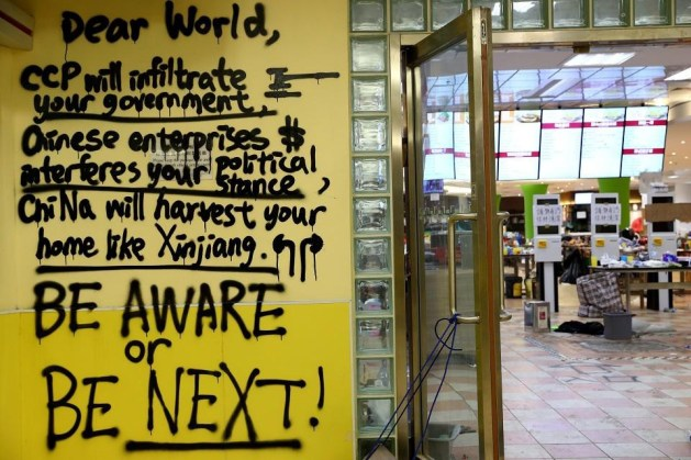 A message is written in graffiti on the campus of the Hong Kong Polytechnic University (PolyU) in Hong Kong