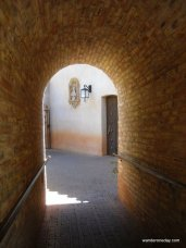These walls serve their only purpose, to keep you moving in one direction, at Tlaquepaque in Sedona, AZ.