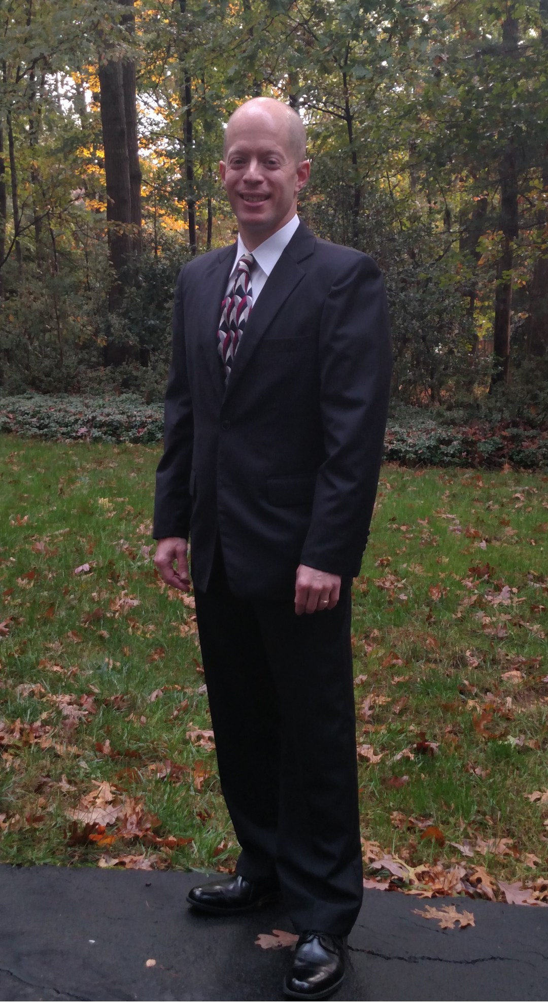 Josh wearing a custom-made suit and shirt