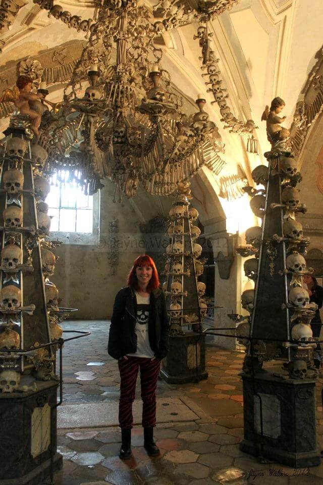 A young me with the famous chandelier, made from every bone in the human body!