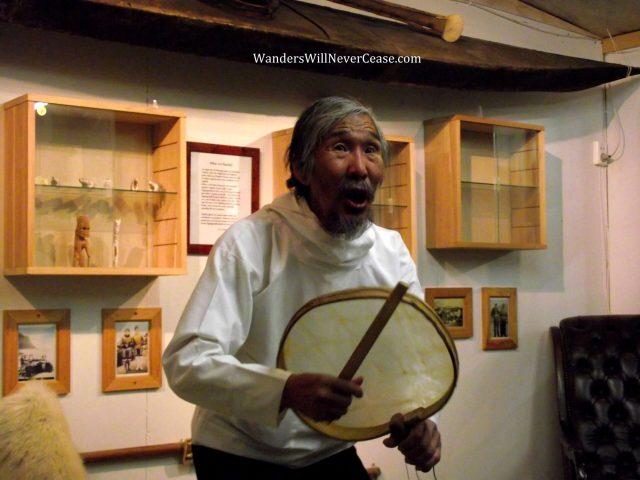 Kulusuk man playing drum in Greenland
