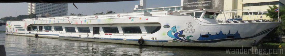 Various boats on Bangkok's Chao Phraya Water Taxi view