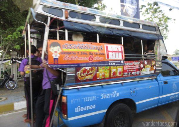 Thailand traffic school kids standing on truck