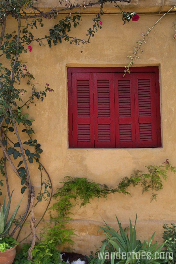 Anafiotika plaka athens greece red shutter window travel photography