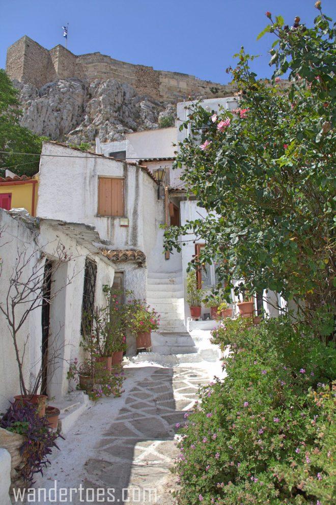 Anafiotika plaka athens greece acropolis greek flag.