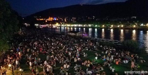 Crowds gathered for Fireworks in Heidelberg Germany. Traveling Happy Plans Ruined