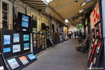 Rue du Tresor, Quebec City street of art for sale. Quebec City shopping artisan souvenirs.